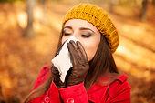 woman-sneezing-handkerchief-autumn.jpg