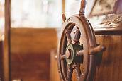 closeup-shot-boat-steering-wheel.jpg