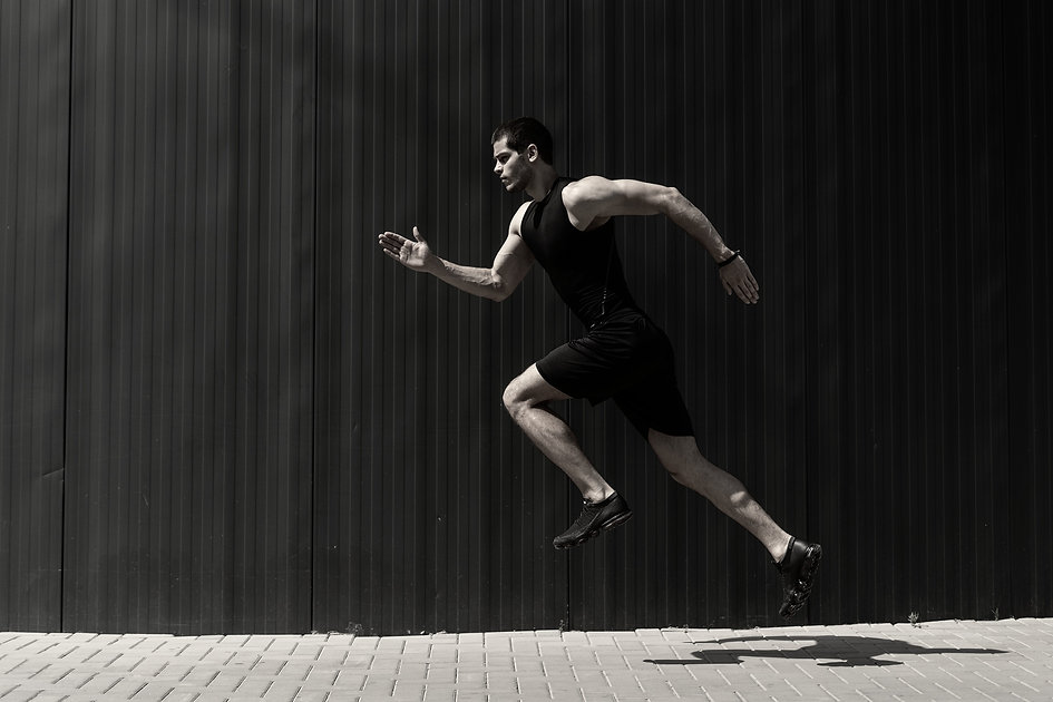 side-view-shot-fit-young-athletic-man-jumping-running_edited.jpg