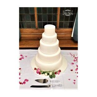 4 tier wedding cake, rum cake, carrot cake, and vanilla sponge