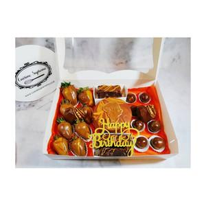 Large rum treat box strawberries, rum balls, rum flavoured brownies, rum cake, brownies and chocolate heart