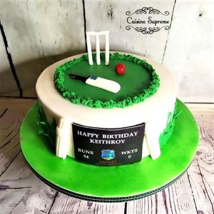 Cricket themed birthday rum cake