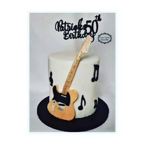 Lemon drizzle 50th birthday guitar themed cake