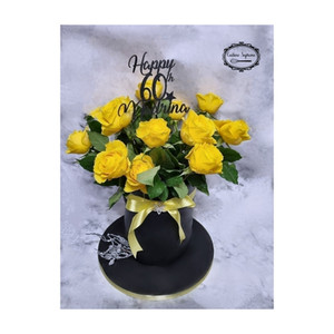 60th birthday rum fruit cake topped with yellow roses