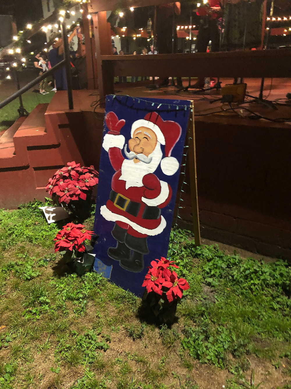 Santa Clause Christmas card on display next to City Park band stand