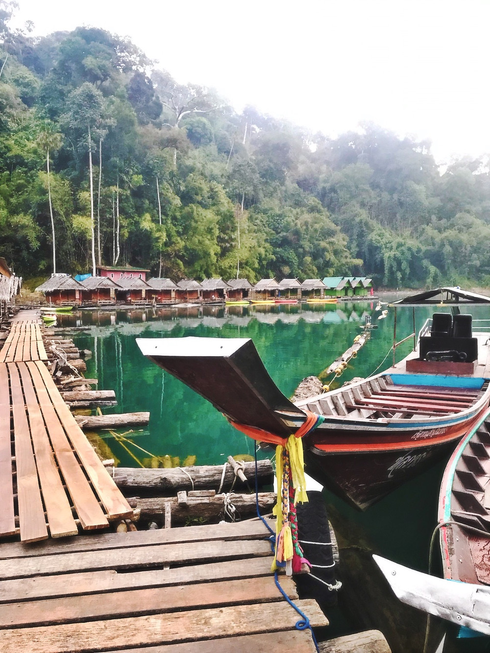 Khao Sok floating bungalow and longtail boat