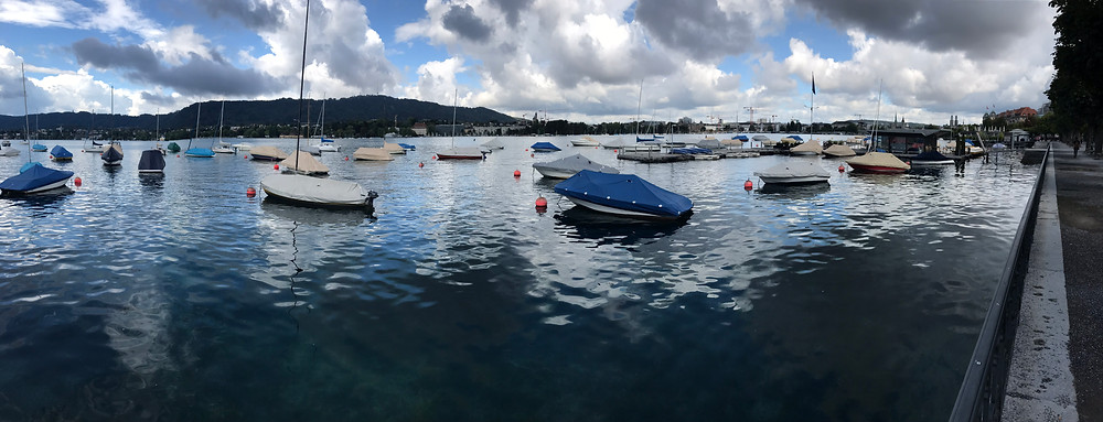 Boats and clouds at the Zurich See (lake)