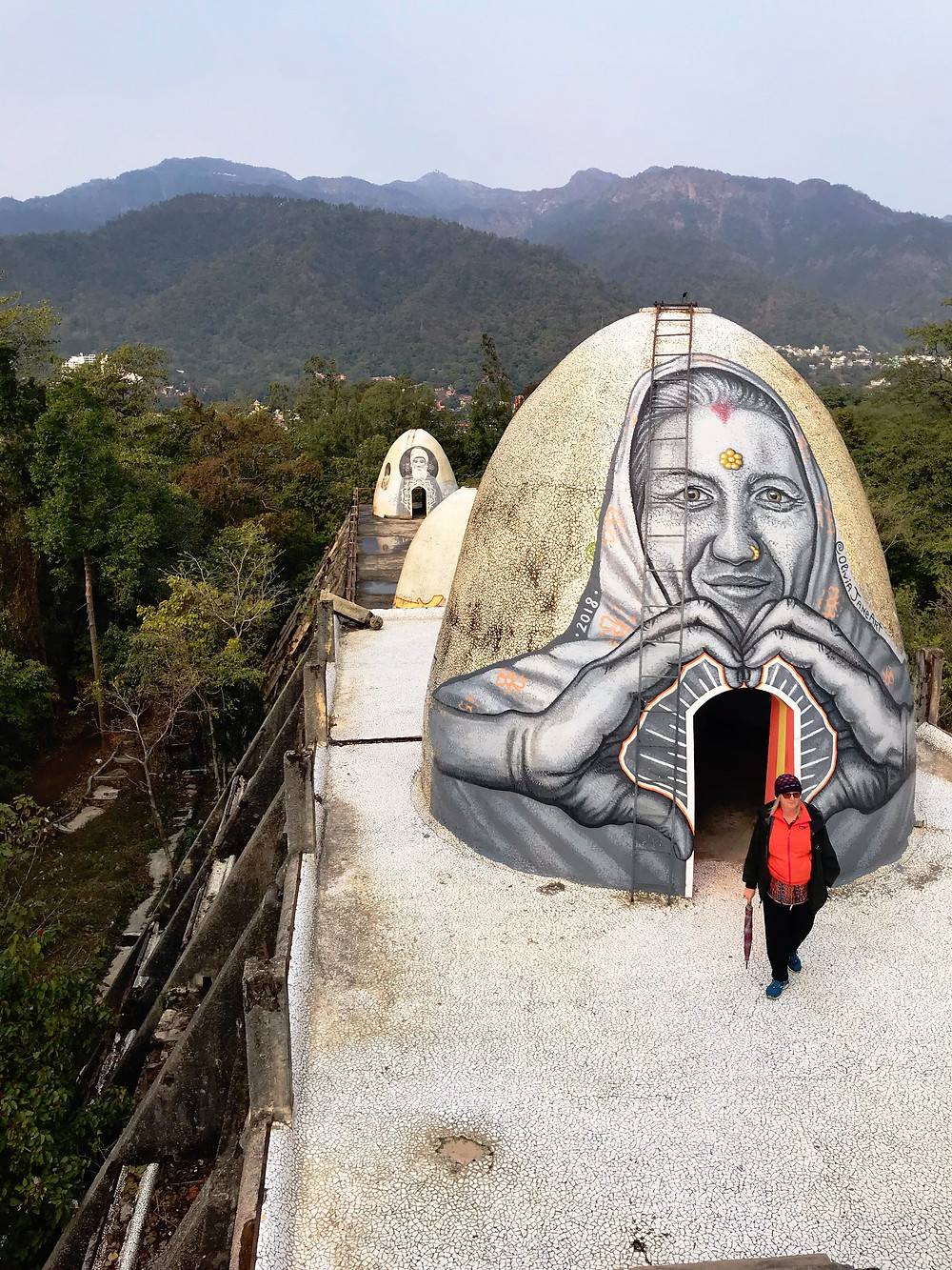 Murals on egg-shaped meditation cave at Beatles Ashram, India.
