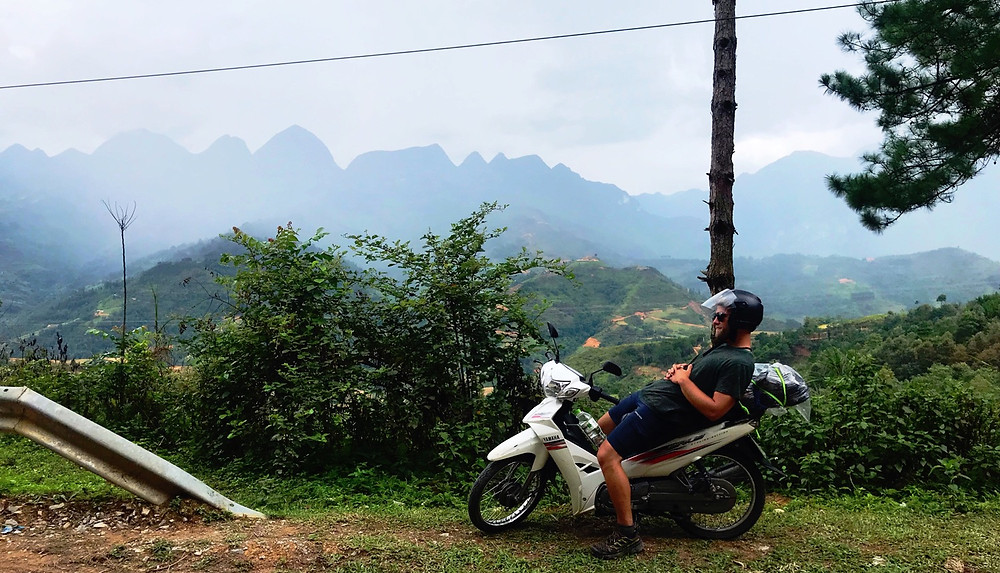 A motorcyclist takes a rest on the Ha Giang Loop, Northern Vietnam