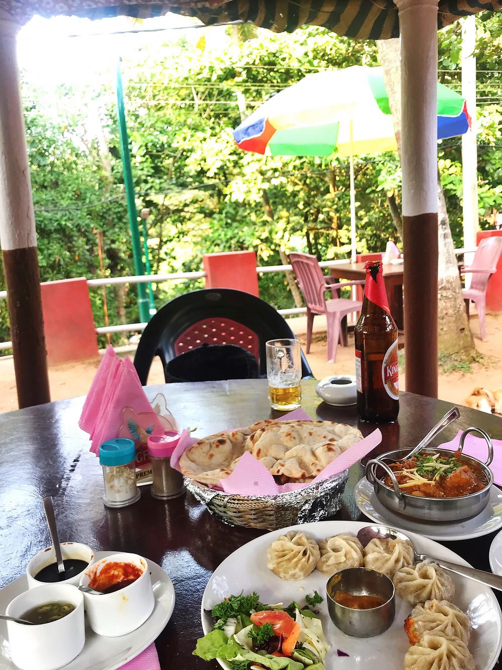 Momos, Kingfisher, and Curry at Mama Chambos, in Varkala