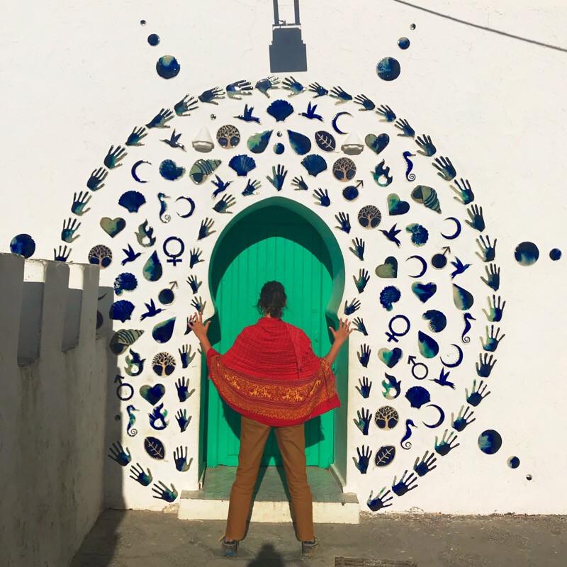 Hand and symbol tile art doorway Asilah Morocco