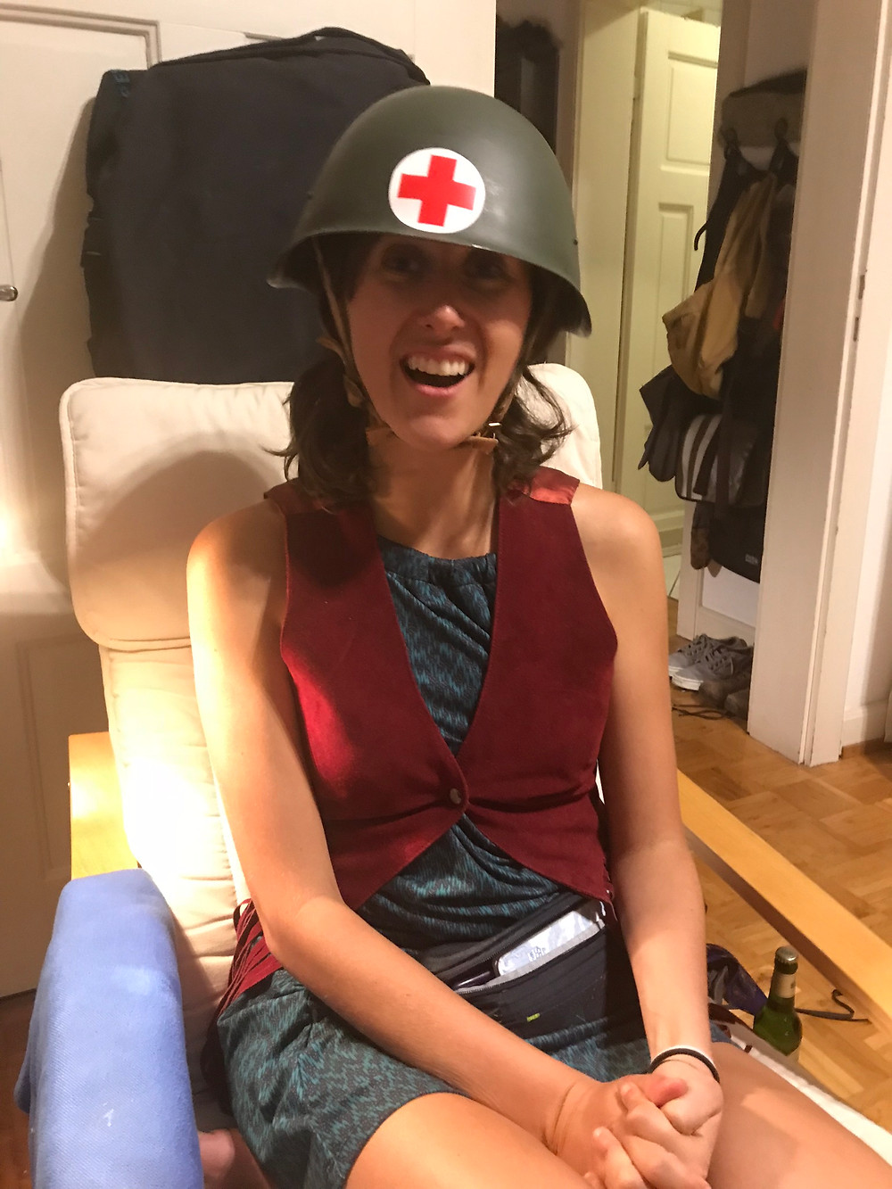 Woman wearing red cross medic helmet.