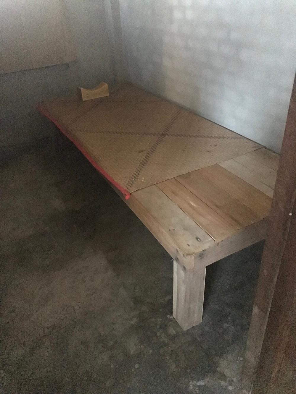 Individual room at Wat Suan Mokkh, wooden pillow
