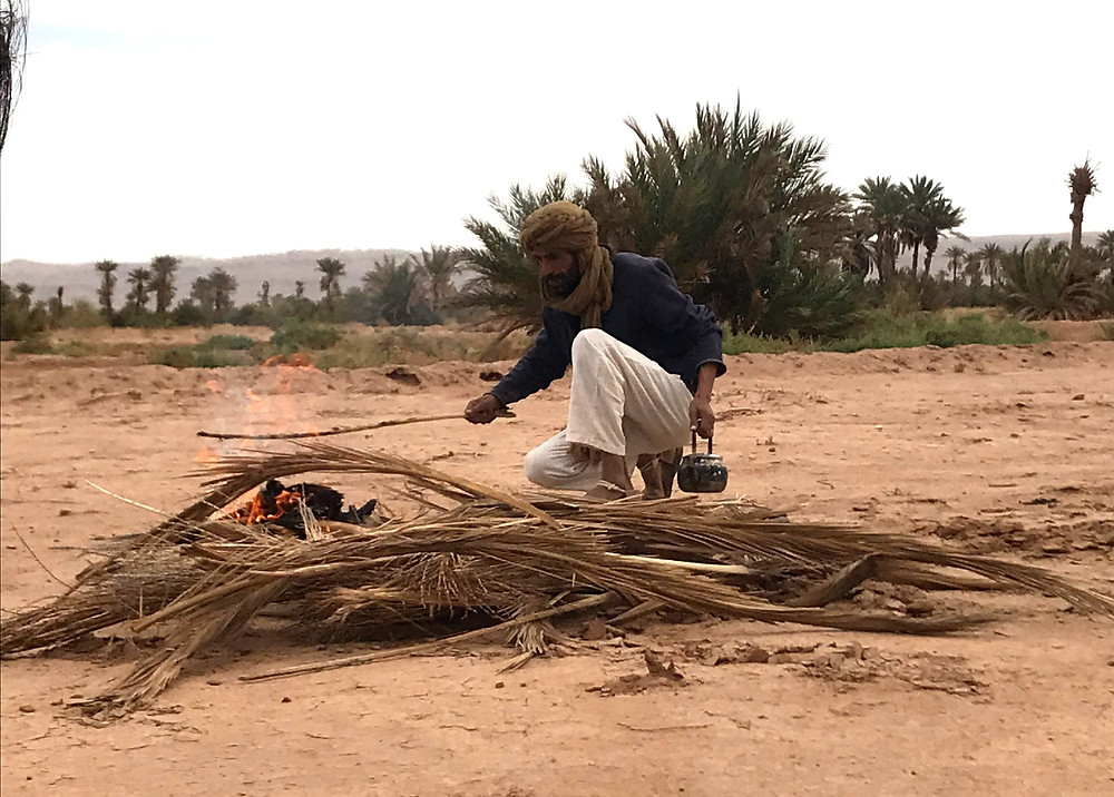 Nomad making mint tea in the desert over fire