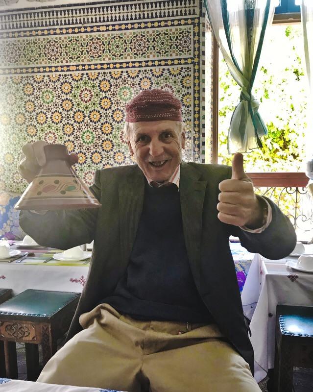 Moroccan tour guide holding tajin