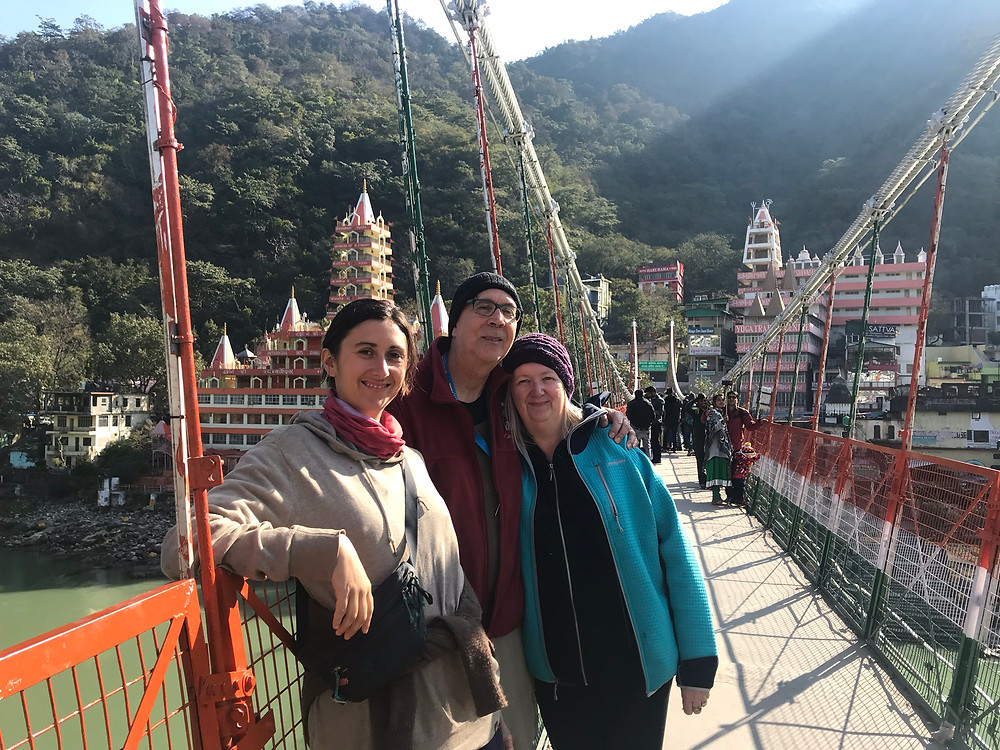 Family posing on the bridge in Rishikesh, India.