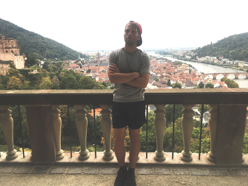 Man at the Heidelberg, Castle overlooking downtown.