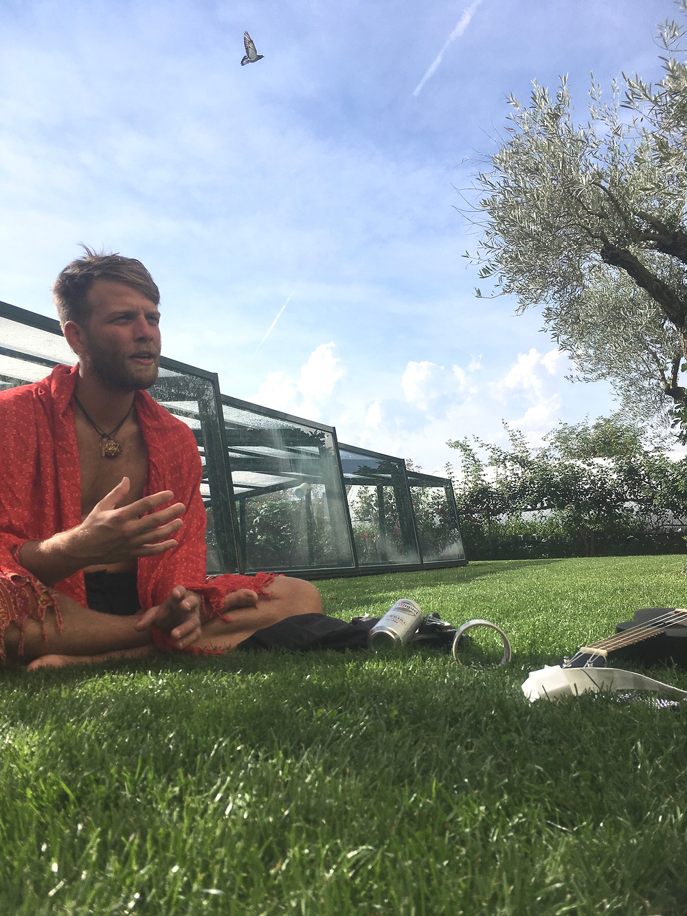 Spiritual man speaking and sitting on the grass