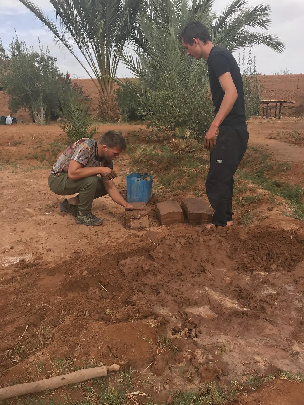 making mud bricks for natural building in desert