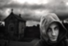Man in hoodie; church; cross