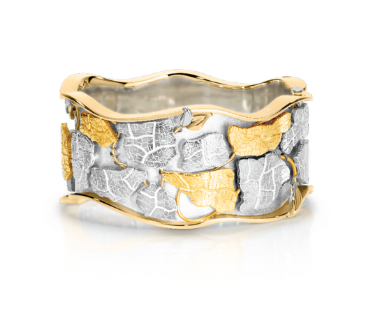 Hugh Thyregod's winning bangle 'Undergrowth' in Sterling Silver, 18 & 9ct yellow, rose and white gold.  Please contact us to enquire about this bespoke piece.