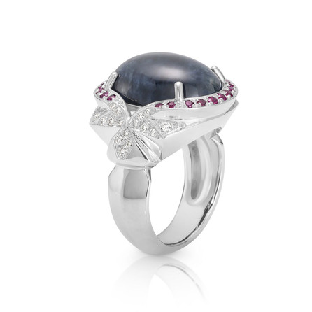 18ct white gold natural cabachan cut Sapphire, with small pavé set Diamonds and Rubies.  Please contact us to enquire about this bespoke piece.