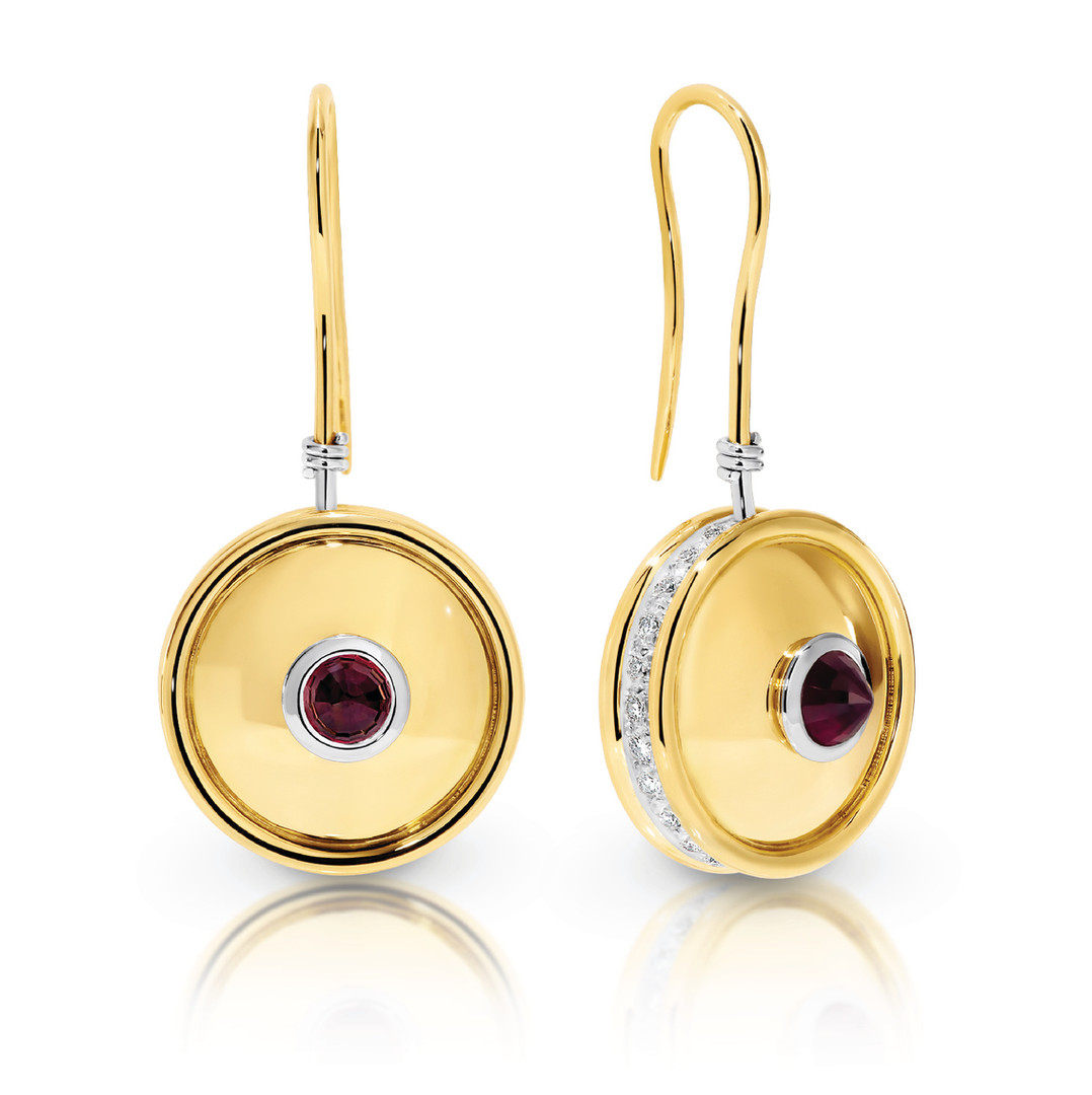 Ruby and Diamond set reversible hanging earrings in 18ct yellow and white gold.  Please contact us to enquire about this bespoke piece.