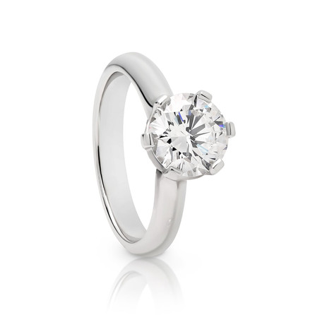 1.78ct round brilliant cut Diamond set solitare in Platinum with small Diamonds around the outside.  Please contact us to enquire about this bespoke piece.