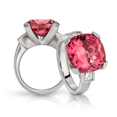 Cushion cut Rubellite Tourmaline and Diamond set ring in 18ct white gold.  Please contact us to enquire about this bespoke piece.