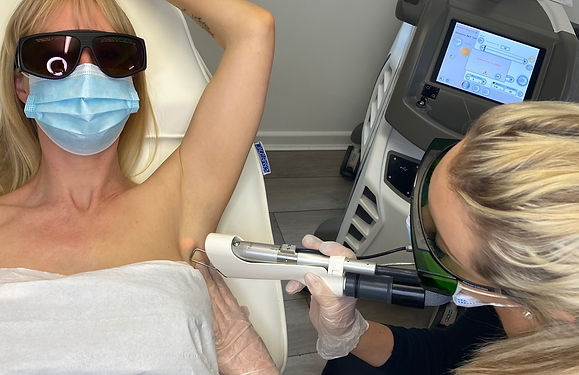 Kate performs a laser hair removal treatment on a client in the Salon in Reading.