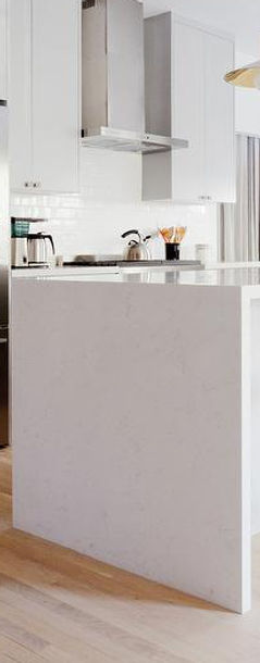 white-quartz-waterfall-island-counter.jp