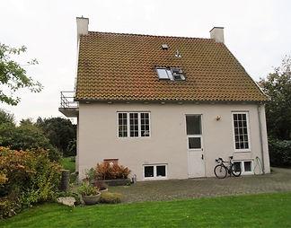 Ombygning med ny tagetage, tilbygning og terrasser - husarkitekten