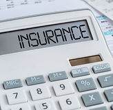 A calculator with the word Insurance on