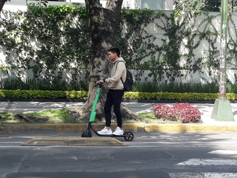 Could COVID-19 revolutionise the daily commute? A review of the new e-scooter trials in the UK