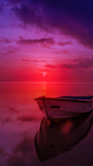 Purple Sunset With Boat On The Lake