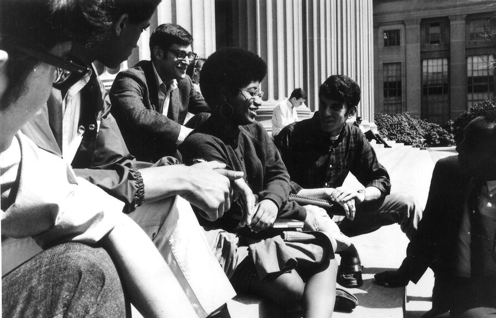 Woman of Tech, Dr. Shirley Jackson sits with colleagues at MIT