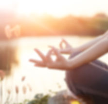 Woman yoga practicing and meditating by