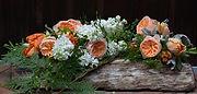 Camas Designs bridal bouquet on driftwoo