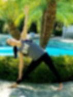 Sun Kissed Yoga teacher in triangle pose.
