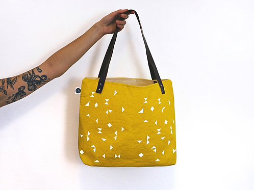Waxed canvas shoulder bag in yellow with triangle pattern