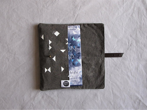 Grey waxed canvas book cover made from organic cotton dyed naturally
