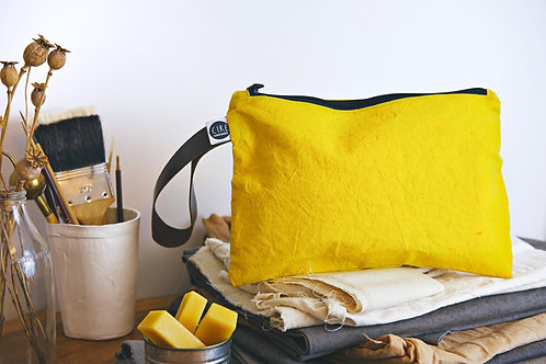 Yellow waxed canvas washbag with leather handle