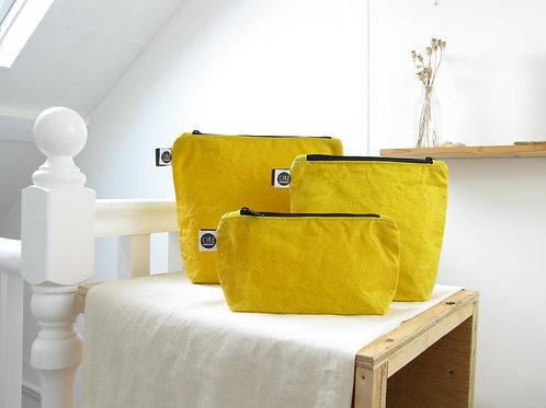 Yellow waxed canvas washbag dyed naturally with turmeric