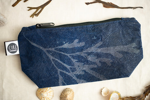 Blue cyanotype bag made from waxed canvas imprinted with seaweed pattern