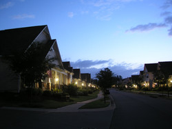 The nighttime streetscape of Old Suwanee