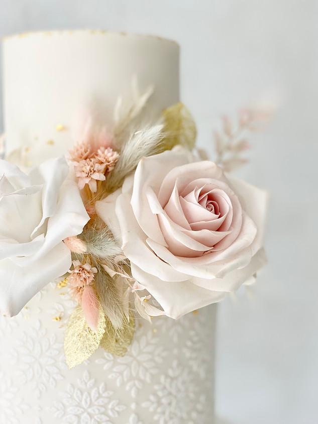Dried flowers two-tier wedding cake.jpeg
