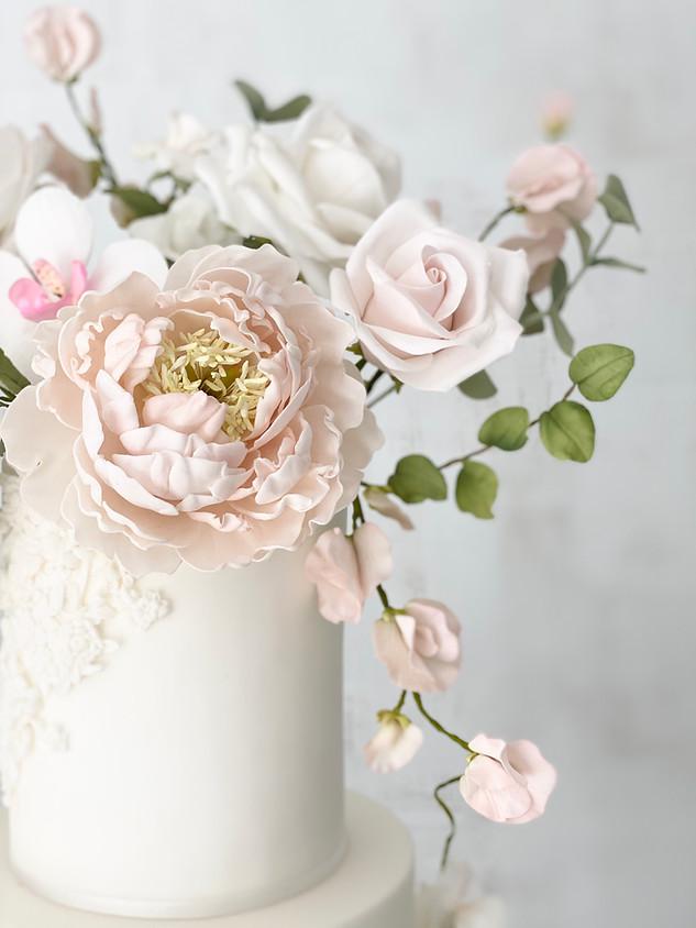 Closeup sugar peony fine art wedding cak