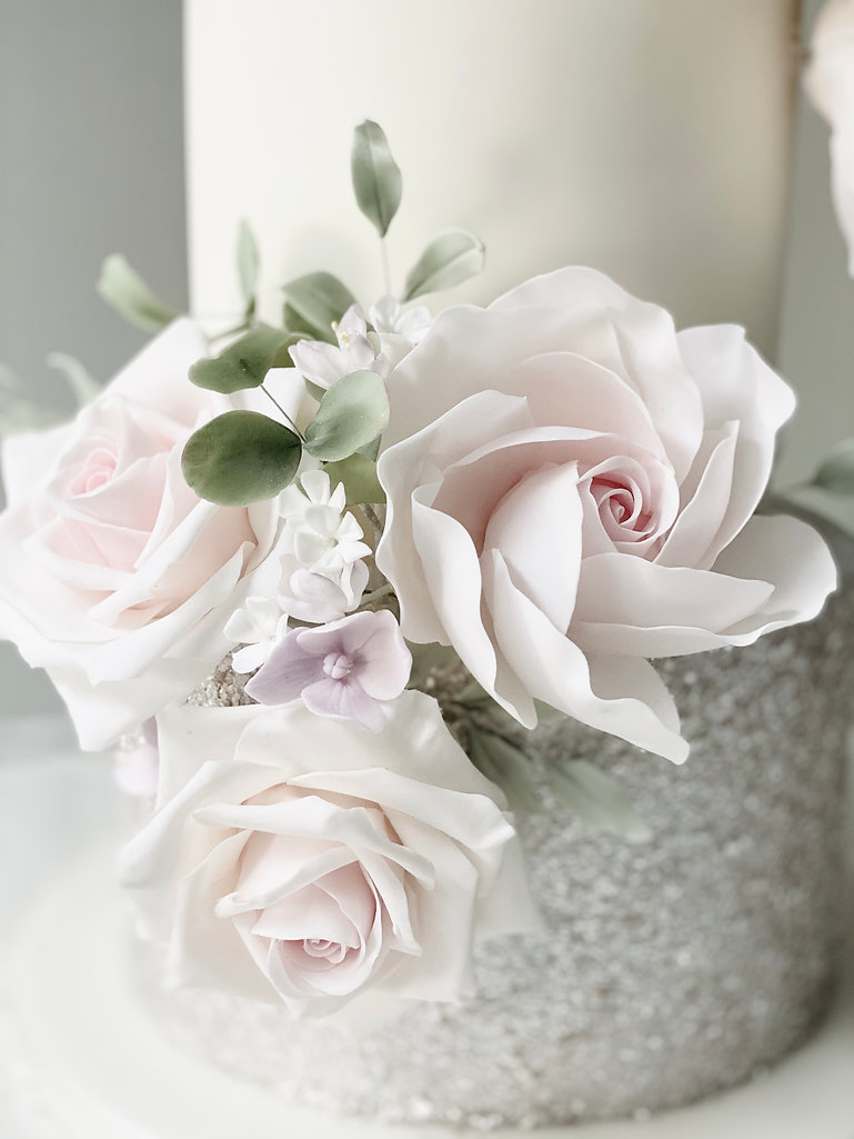 Blush and silver wedding cake close-up