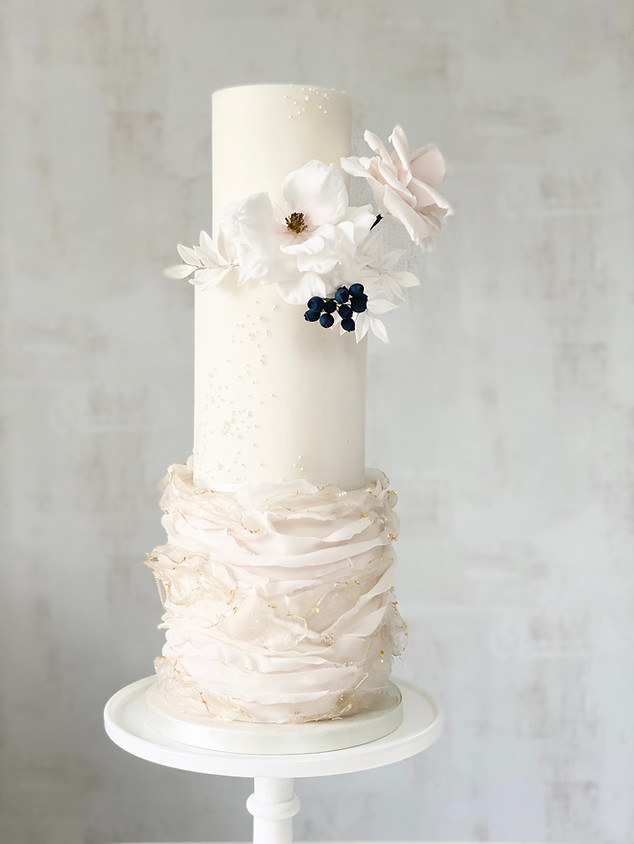 Ruffle and pearl luxury wedding cake