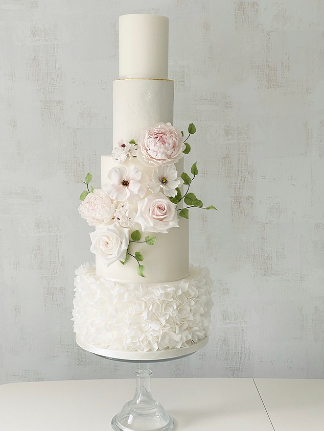 Wedding cake with peonies and wafer peta